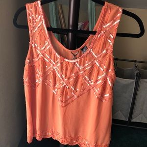 Burnt orange sleeveless blouse from Buckle store